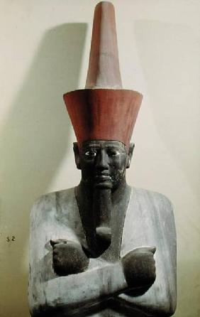 Detail of a statue of Mentuhotep II, enthroned and wearing the red crown of Lower Egypt, taken from