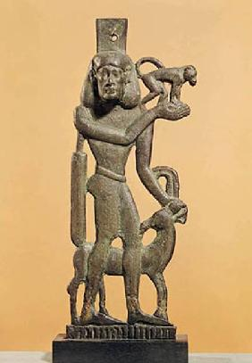Figure of a man holding a monkey with an ibex licking his knee, Saite Period