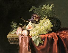 A still life with grapes, plums, figs and a melon on a partly draped stone ledge 1653